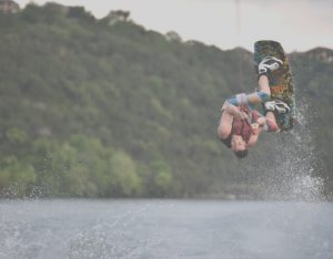 man jumps on wakeboard